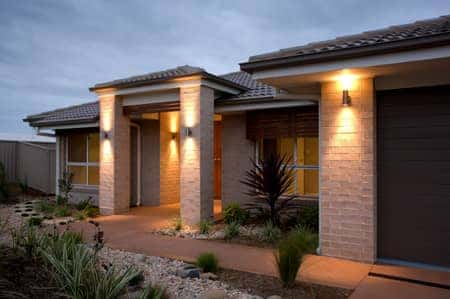 A new home with attractive outdoor lighting.