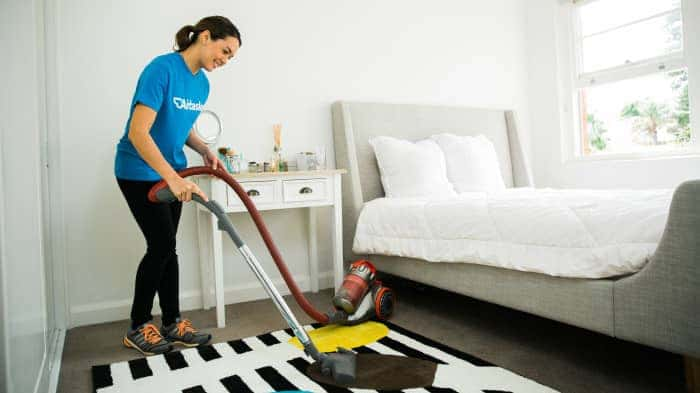 woman cleaning carpet