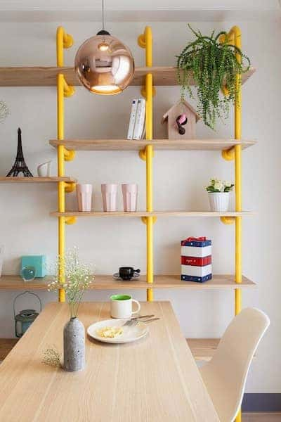 interior-design-ideas-dwell-tube-bookcases-diy-wohnideen-yellow-shelves