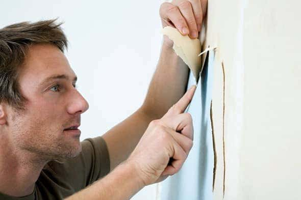 Man-Is-Removing-Wallpaper