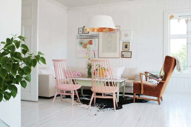 Light-and-Bright-Scandinavian-Living-Room-with-Pastel-Pink-Chairs-Also-Modern-Cowhide-Rug