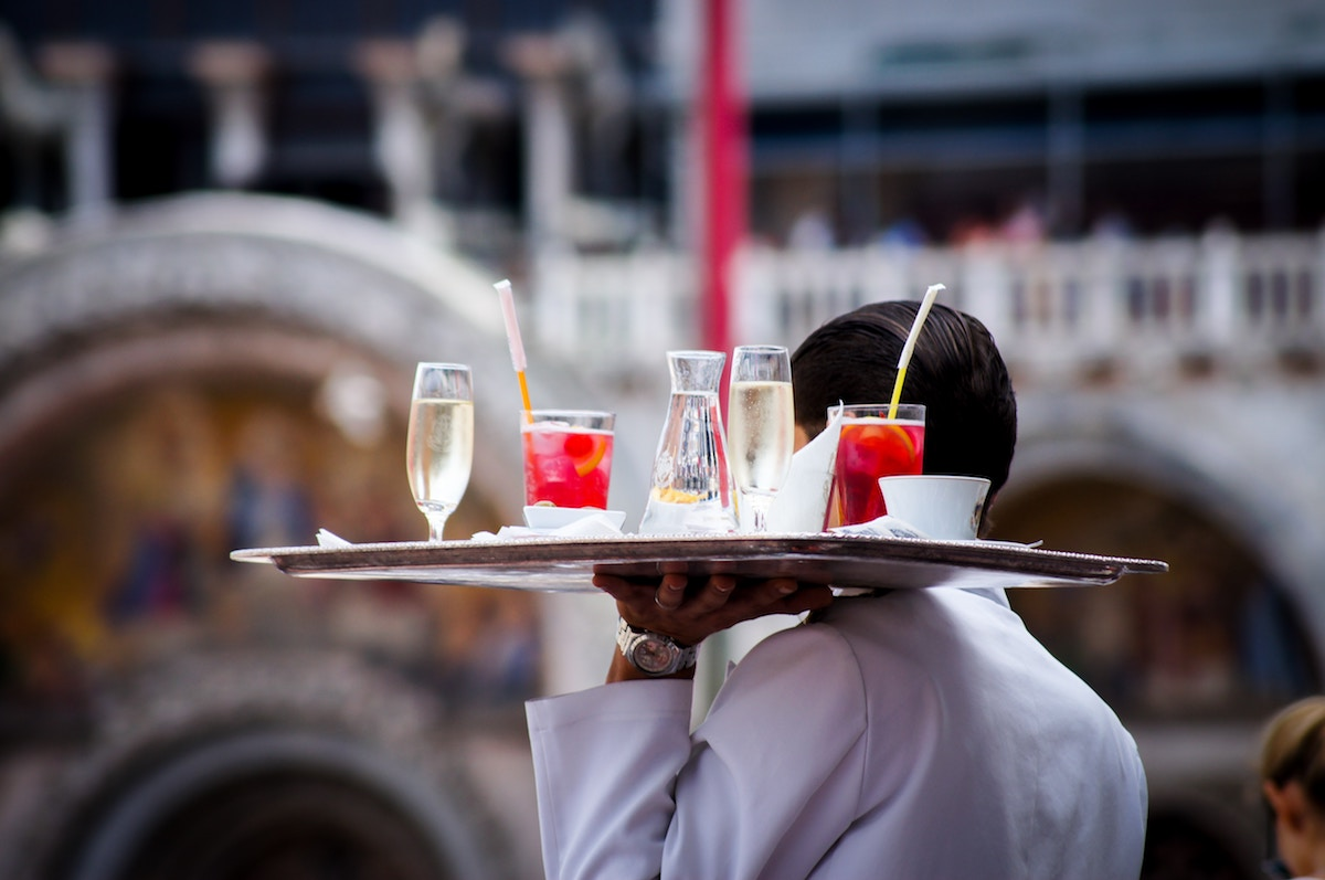 waiter holding drinks tray