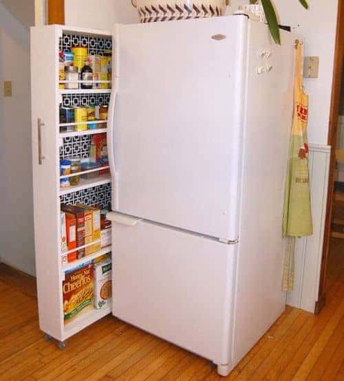 extra storage next to fridge in a small kitchen