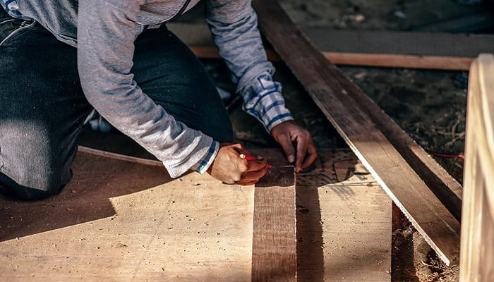 Carpenter measuring to cut