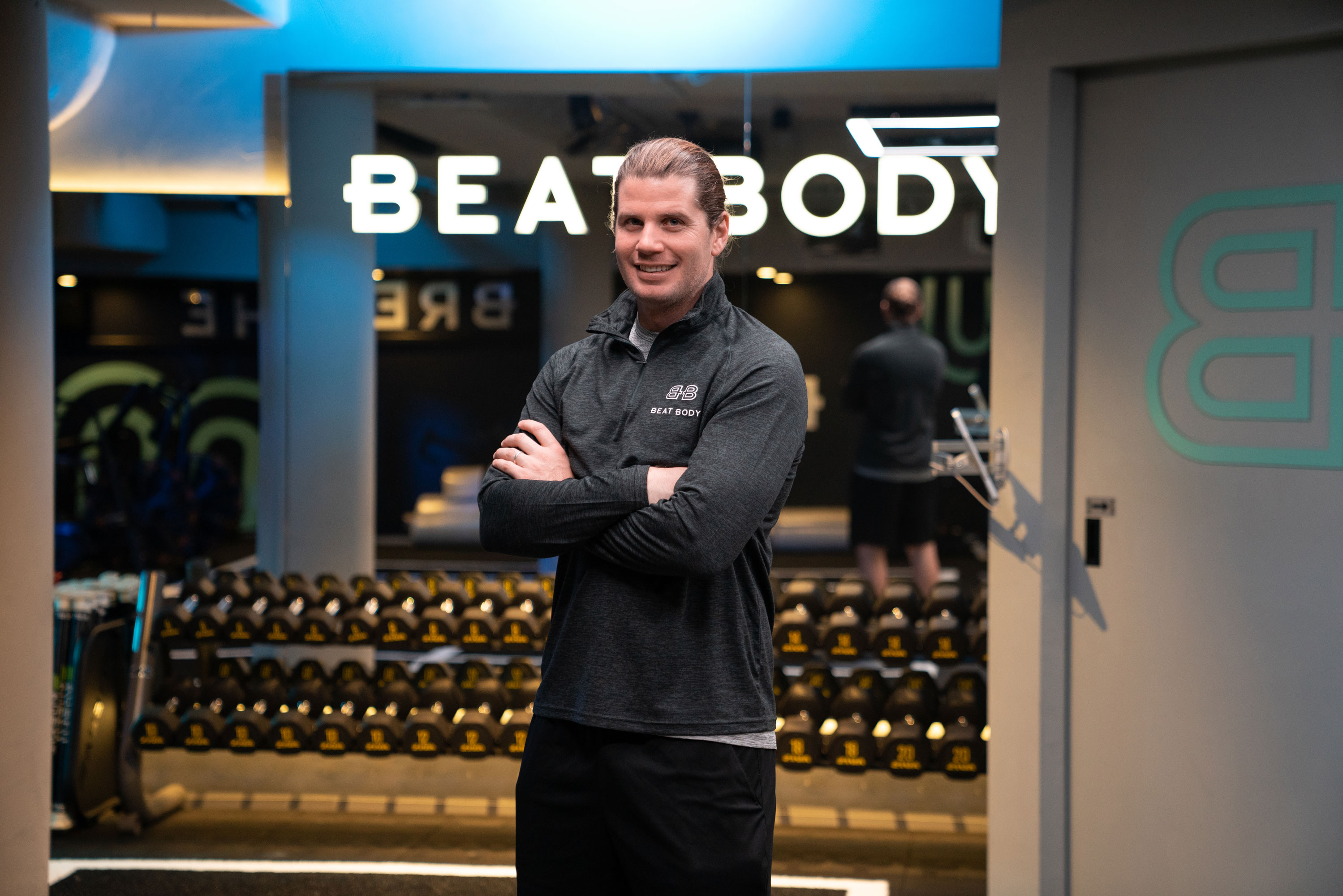 Australian start up founder Tom of Beat Body gym in front of weigh rack