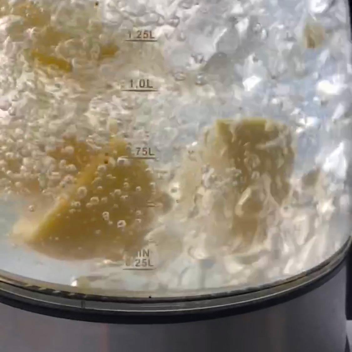 lemons being boiled in kettle