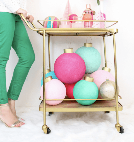 gold bar cart with giant Christmas baubles