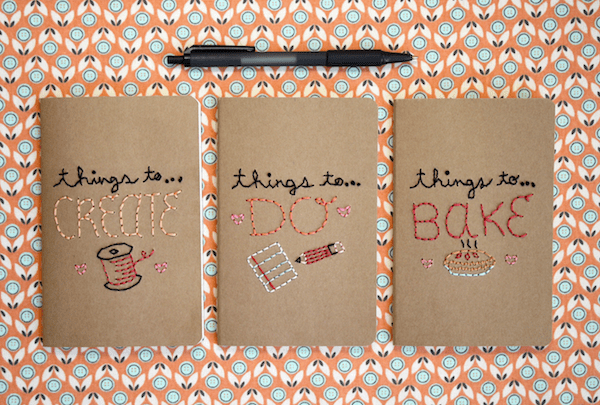 embroidered notebooks on printed fabric