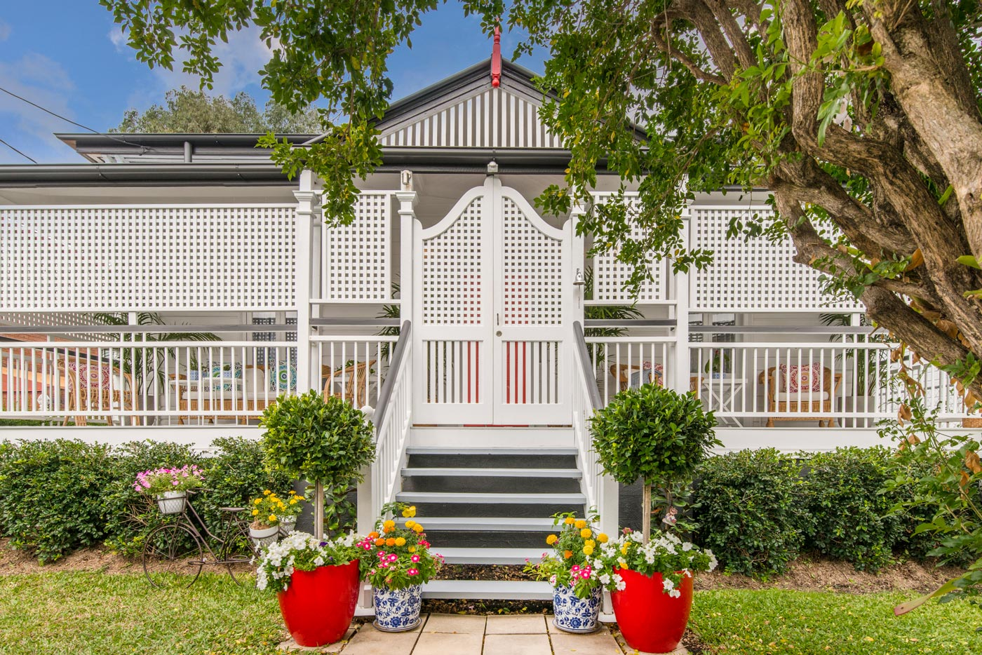 Traditional Queenslander house white fence Airbnb