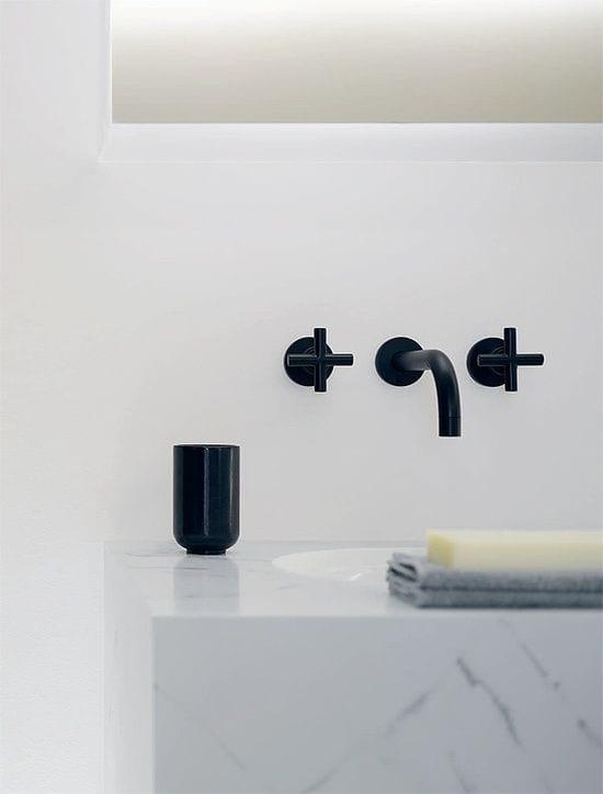 Black taps in a white bathroom