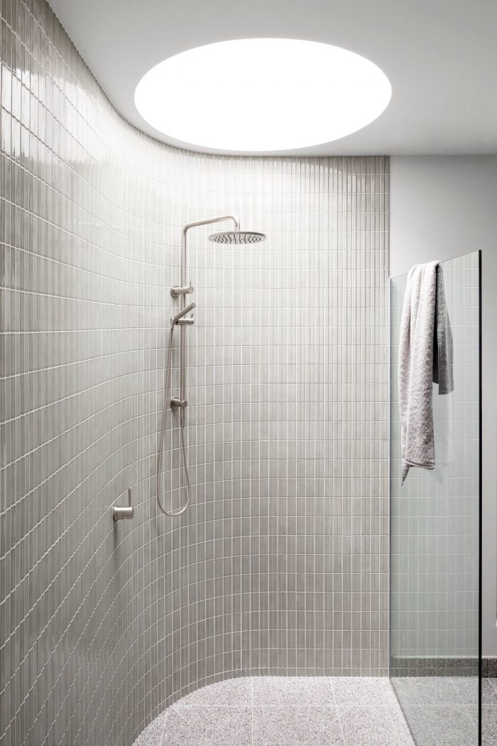 Bathroom with curved walls and skylight