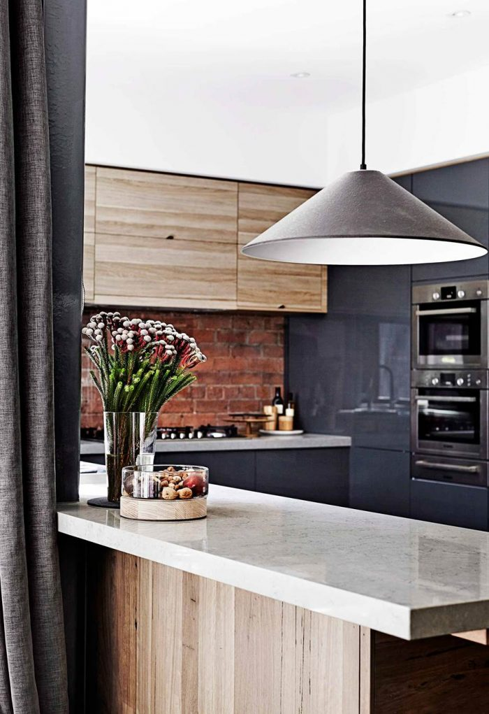 Exposed brick kitchen splashback