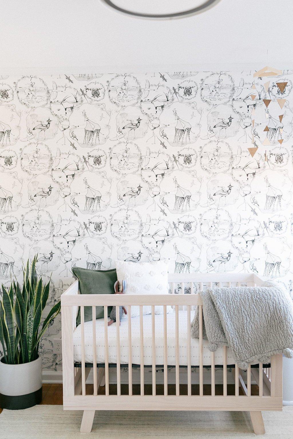 Nursery with animal wallpaper