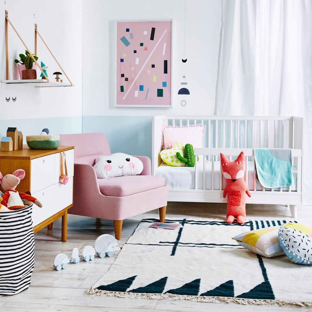 Quirky pillows in nursery