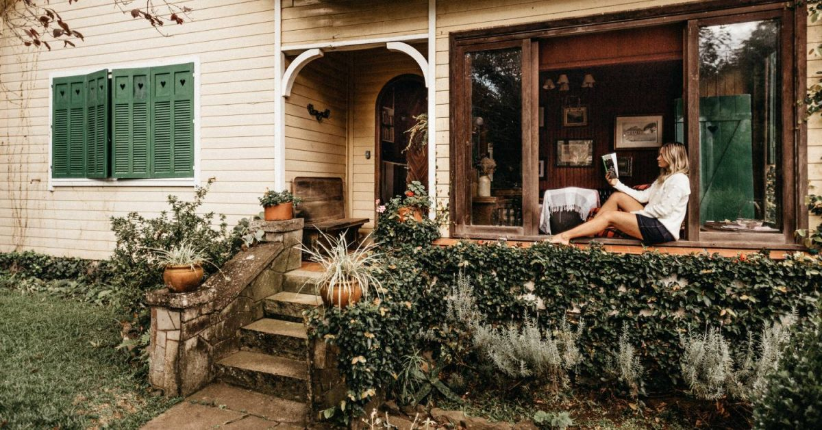 woman reading on front porch
