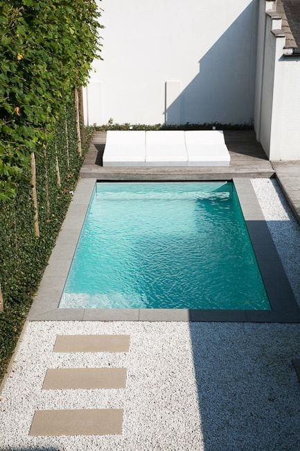 small pool with paver path