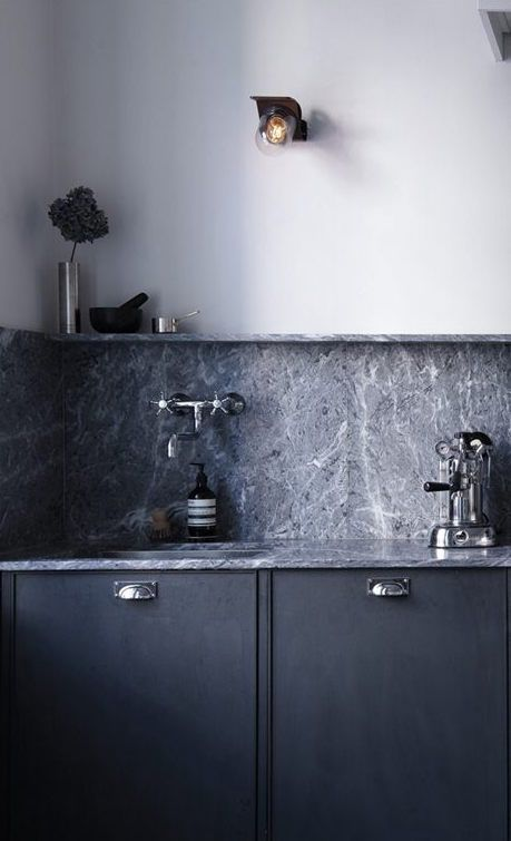 grey stone counter and chrome fittings
