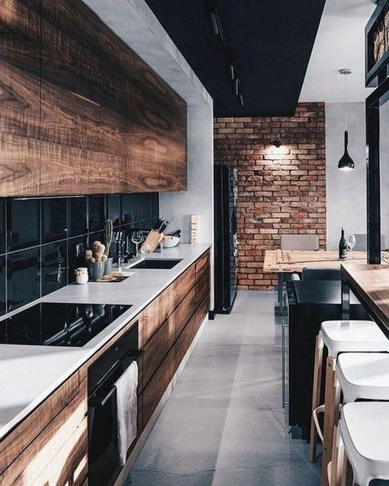 black and wood and black tile backsplash