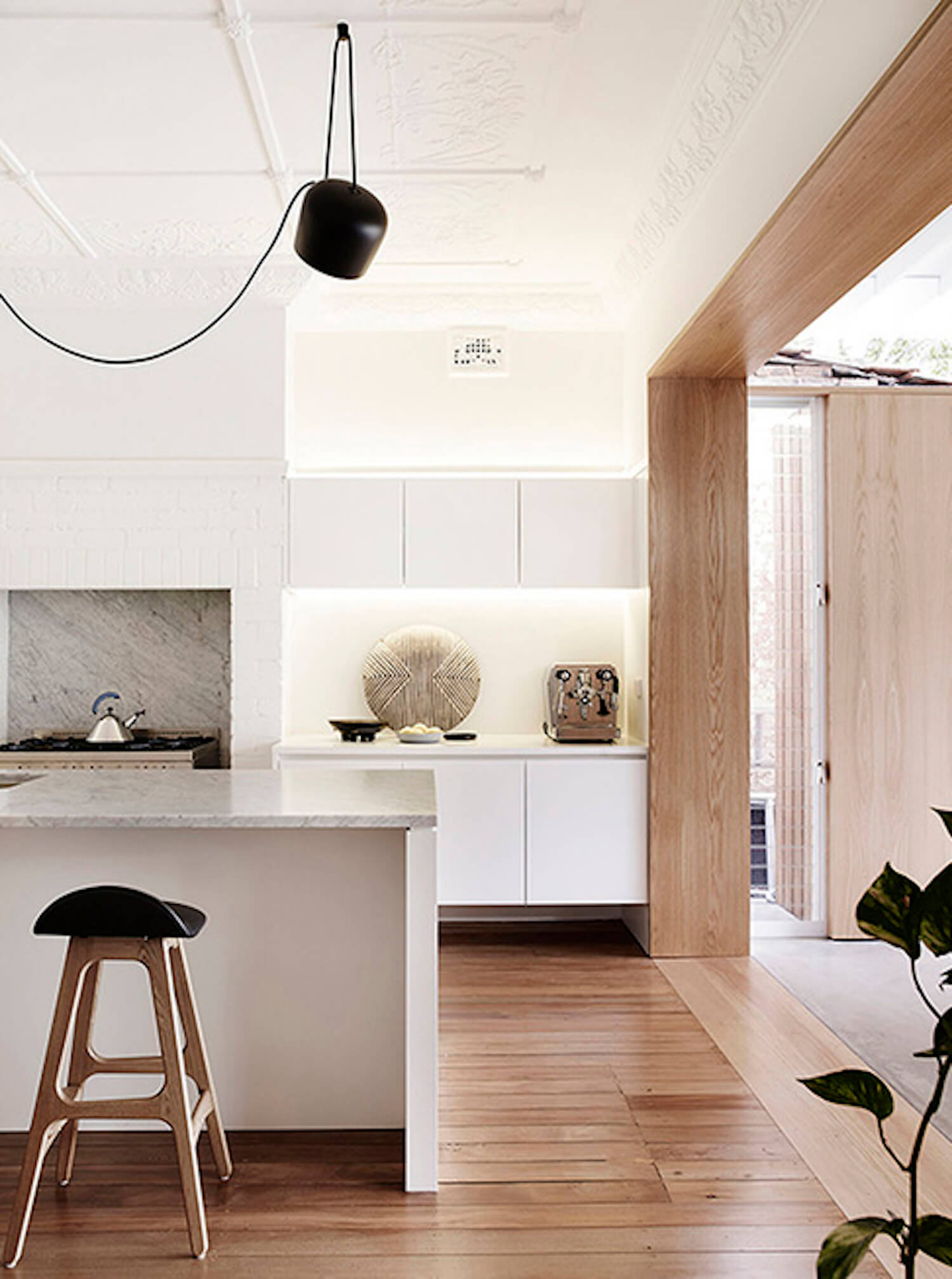 timber between kitchen and dining
