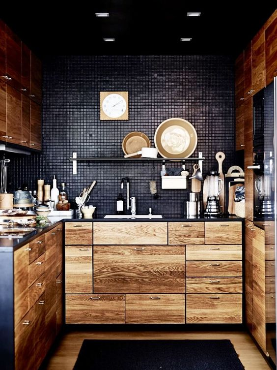 timber cabinetry against black tile