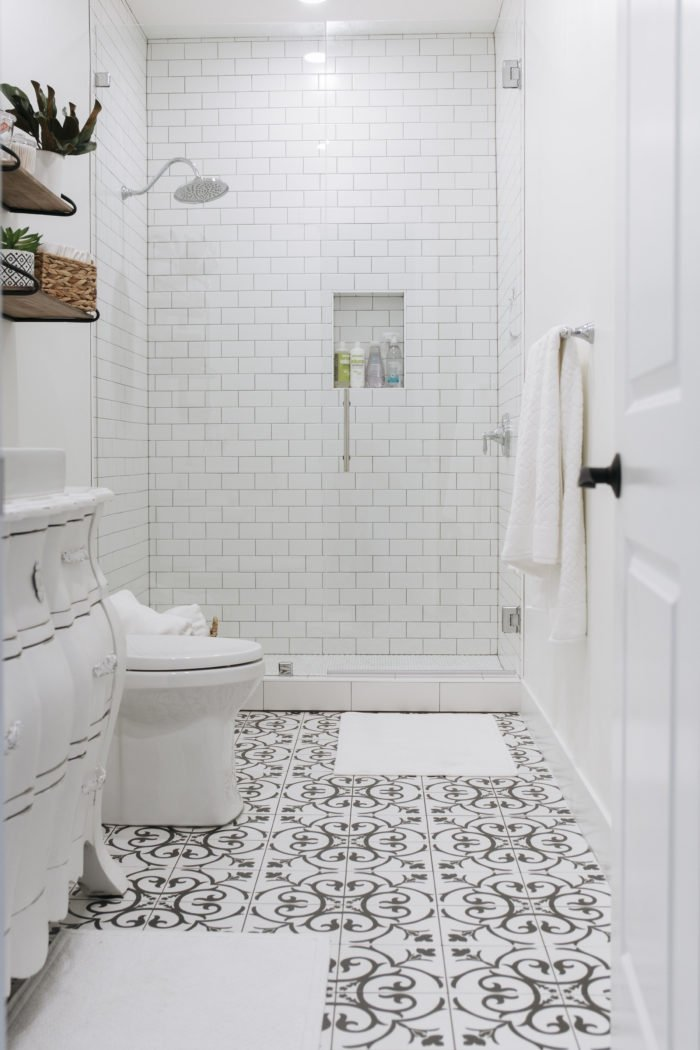 White bathroom with patterned tiles