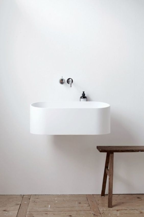 white floating sink with black accents