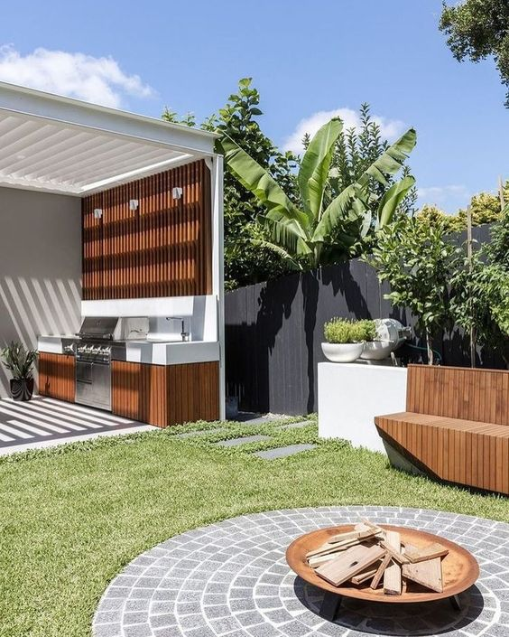 outdoor kitchen with tiled fire pit area