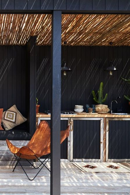 thatched roof outdoor kitchen