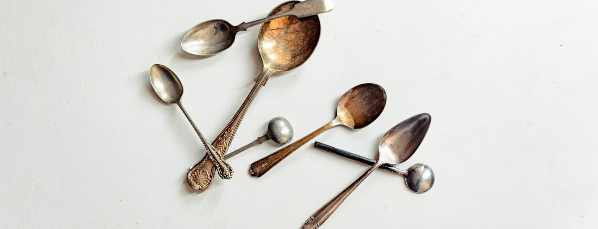 tarnished silver cutlery