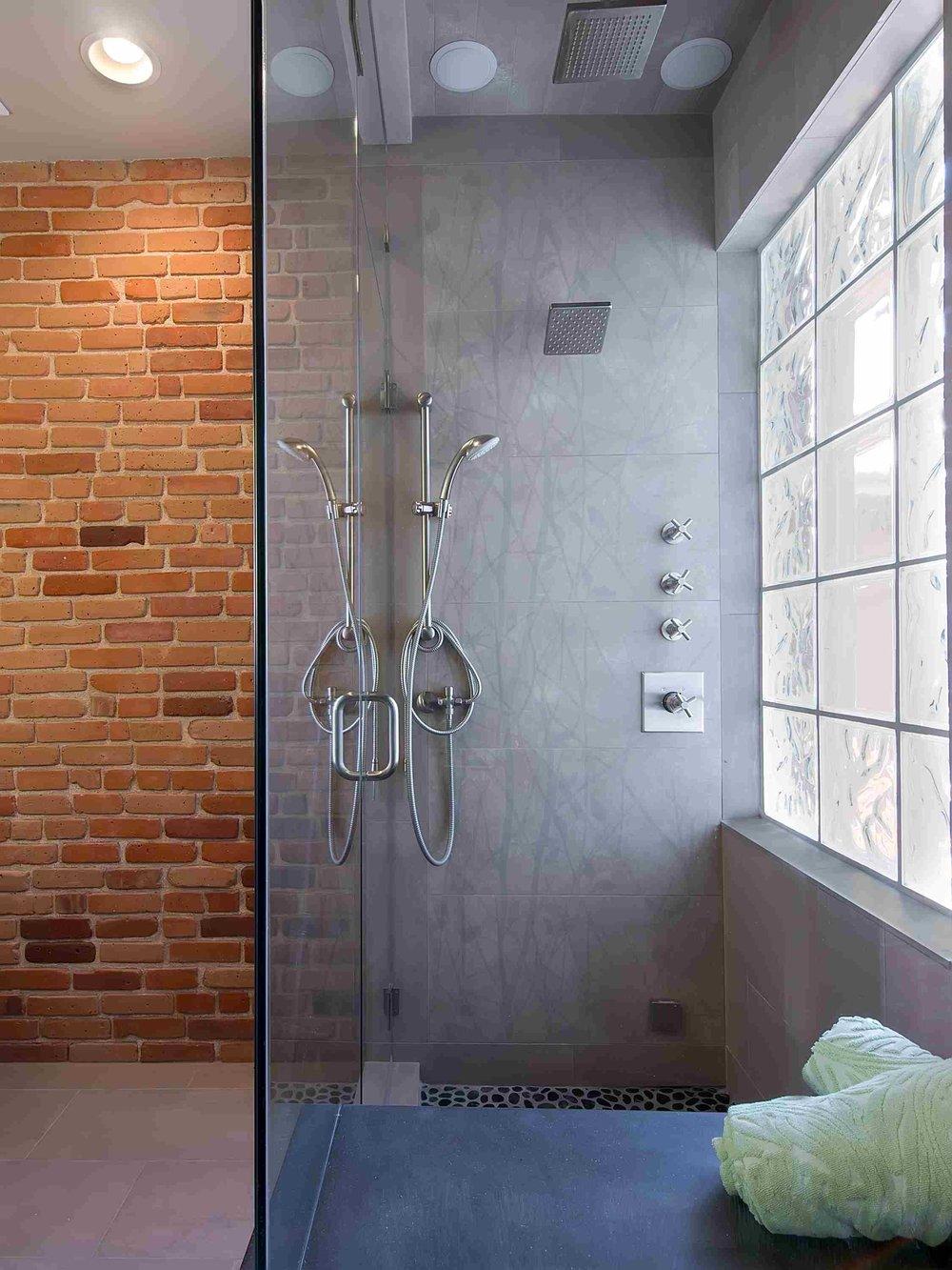Brick and concrete bathroom