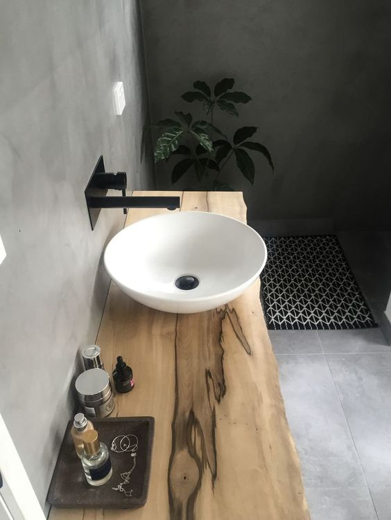 raw timber vanity with black tapware