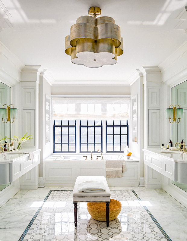 Grand bathroom with a gold light