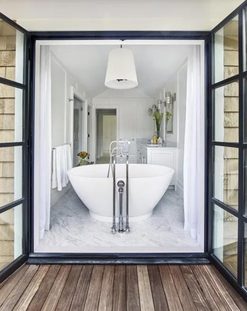 Open bathroom with balcony