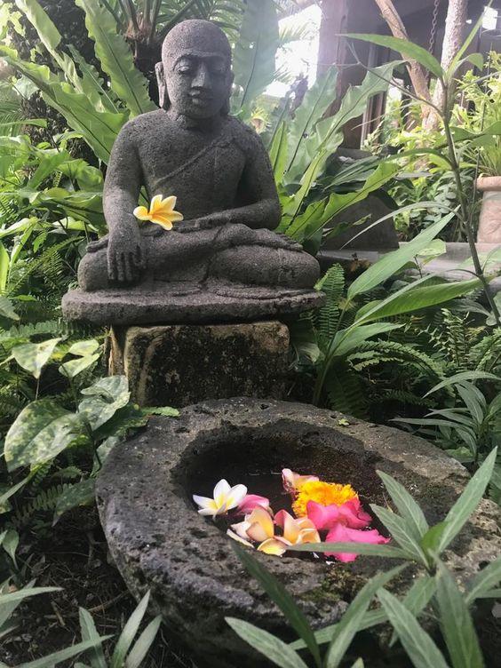 stone deities tropical garden ideas