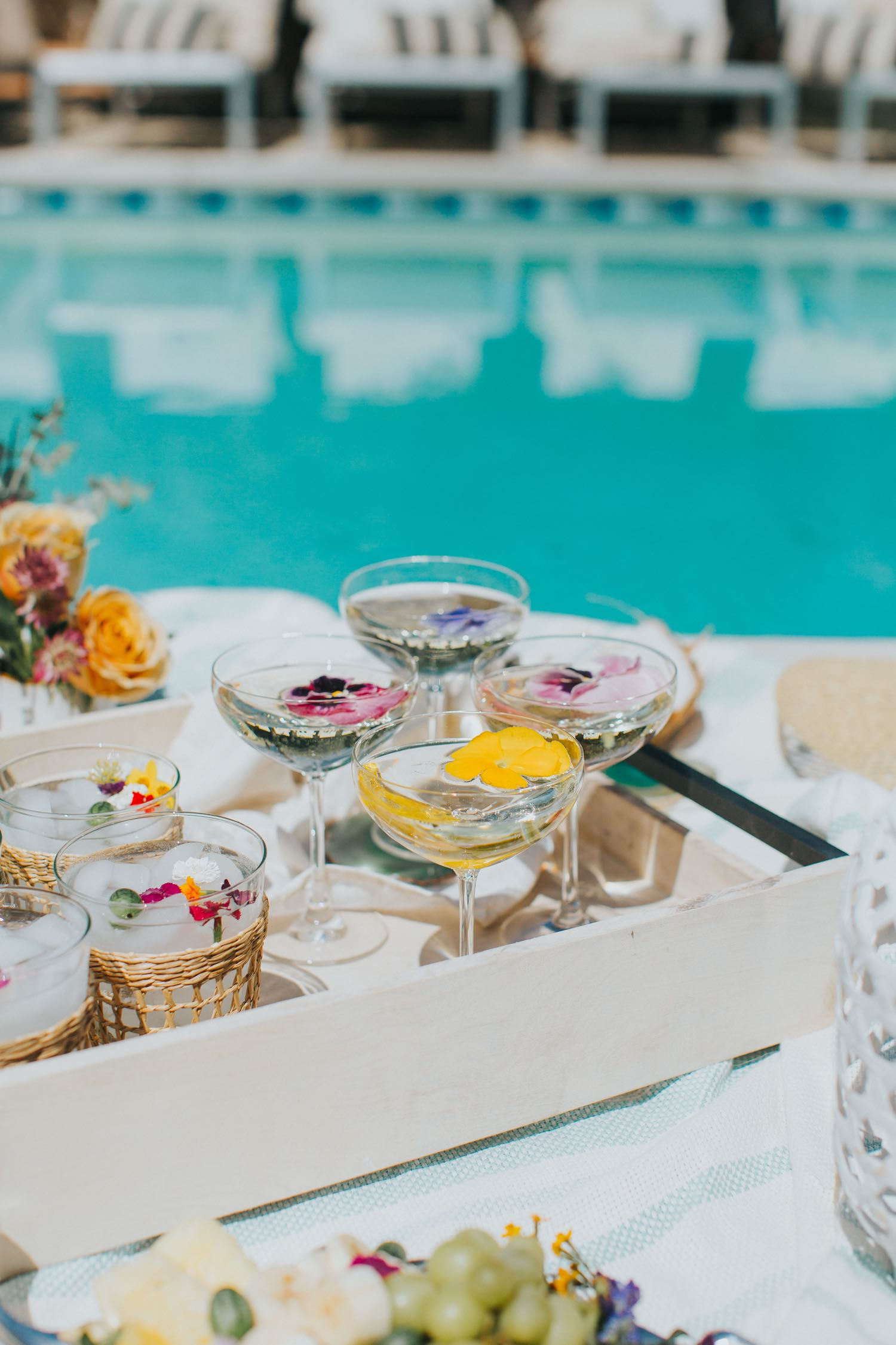 flower cocktails next to pool