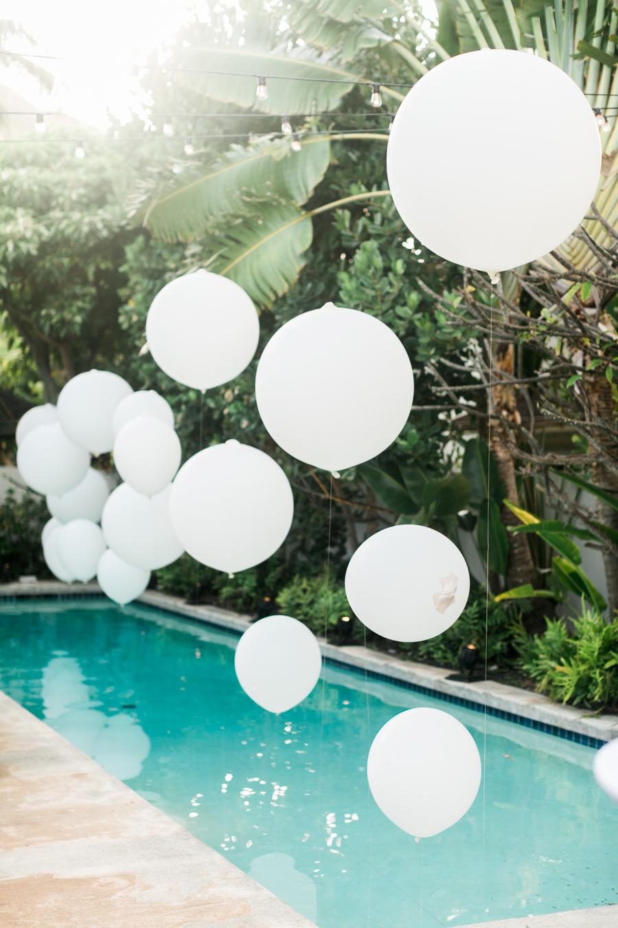 white balloon above pool
