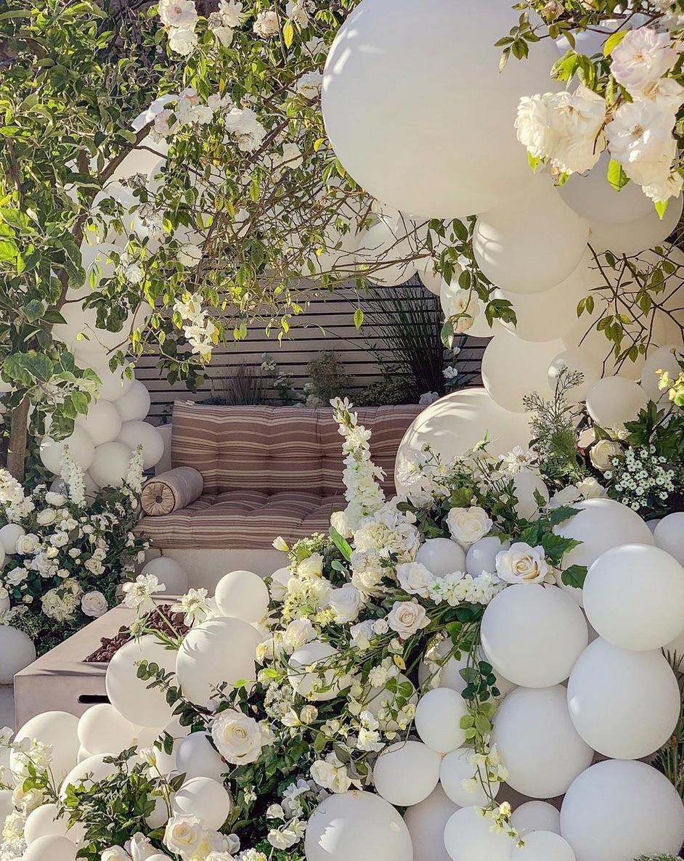 white balloon and flower garden party