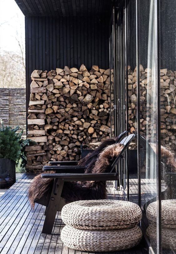 black verandah with woodstack