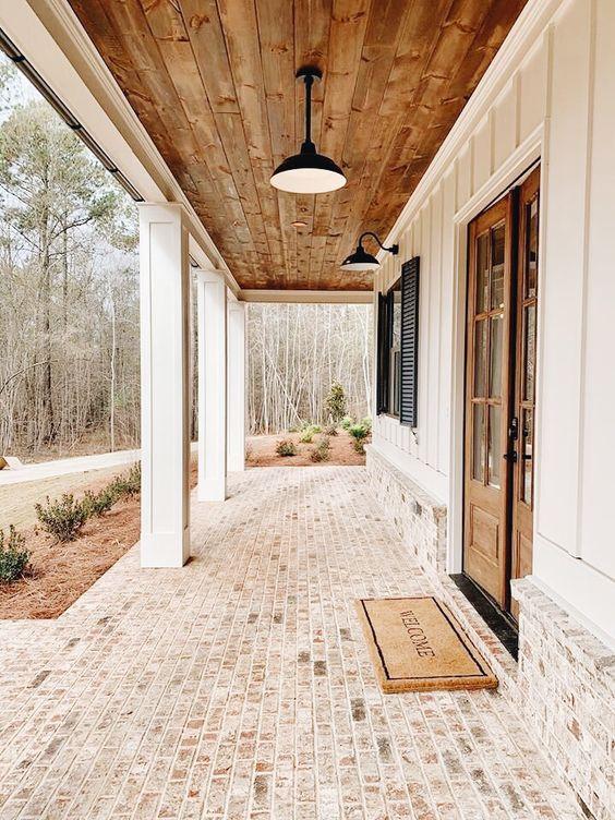 whitewashed brick and barn lights