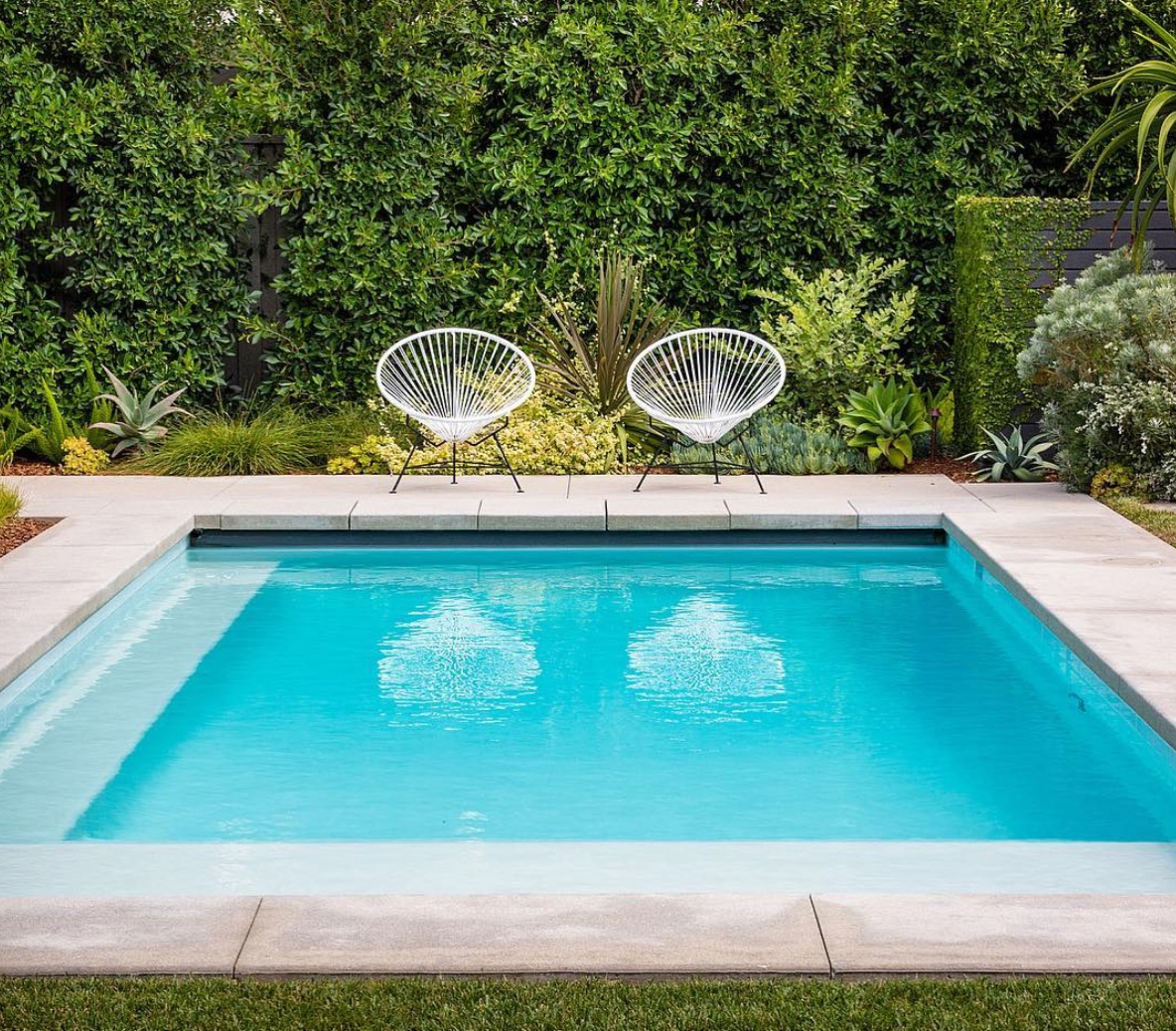 Square small pool with ledge seating