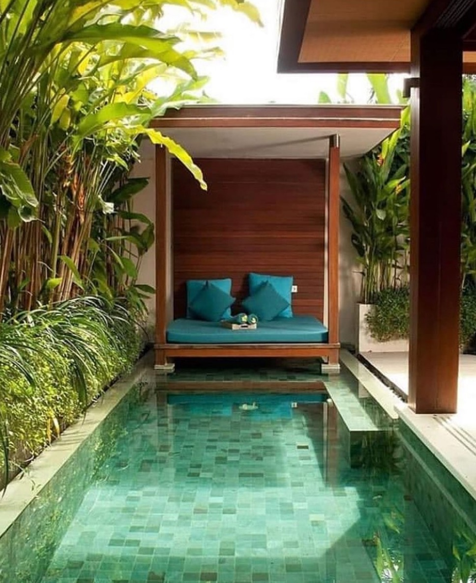 Tropical small pool with green tiles
