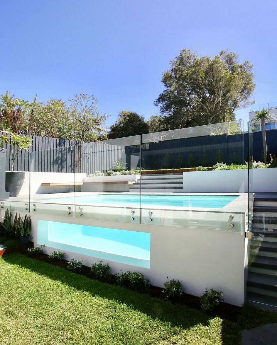 Glass pool fencing around above ground pool
