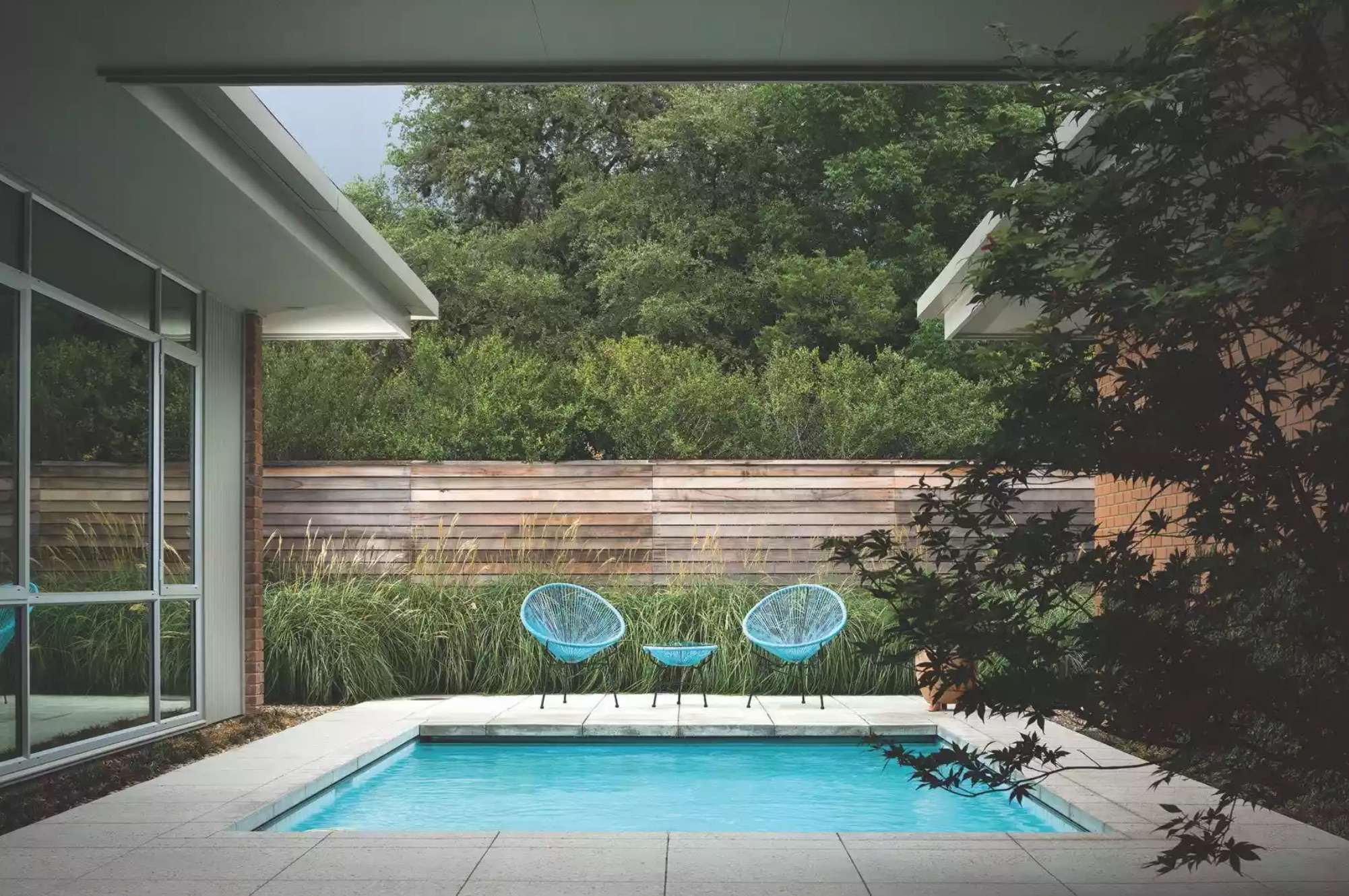 Mid-century style home with a small pool
