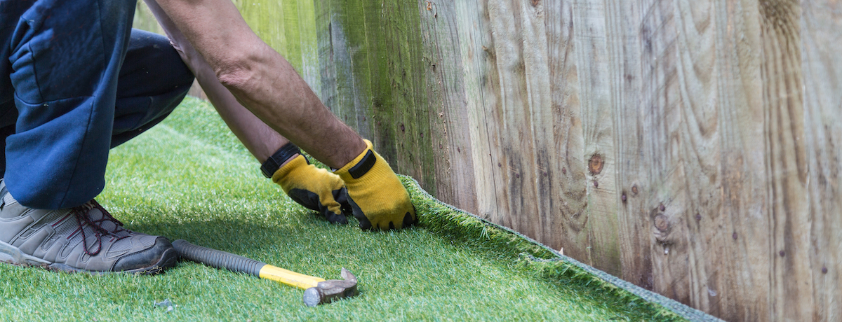 laying-artificial-turf
