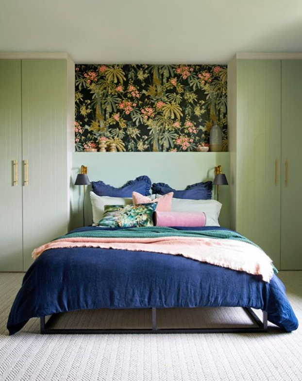 green bedroom with built ins next to bed