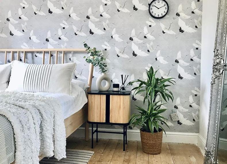 Grey bird wallpaper in bedroom