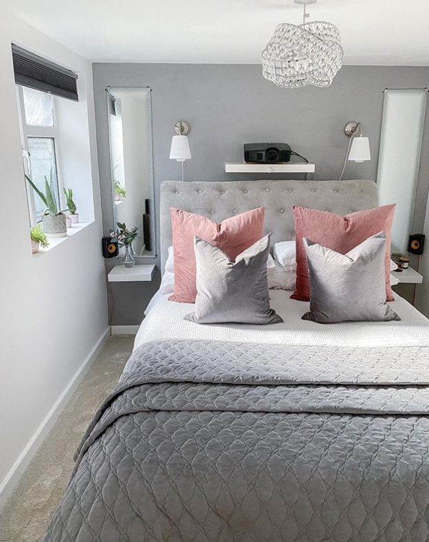Grey bedroom with pink pillows