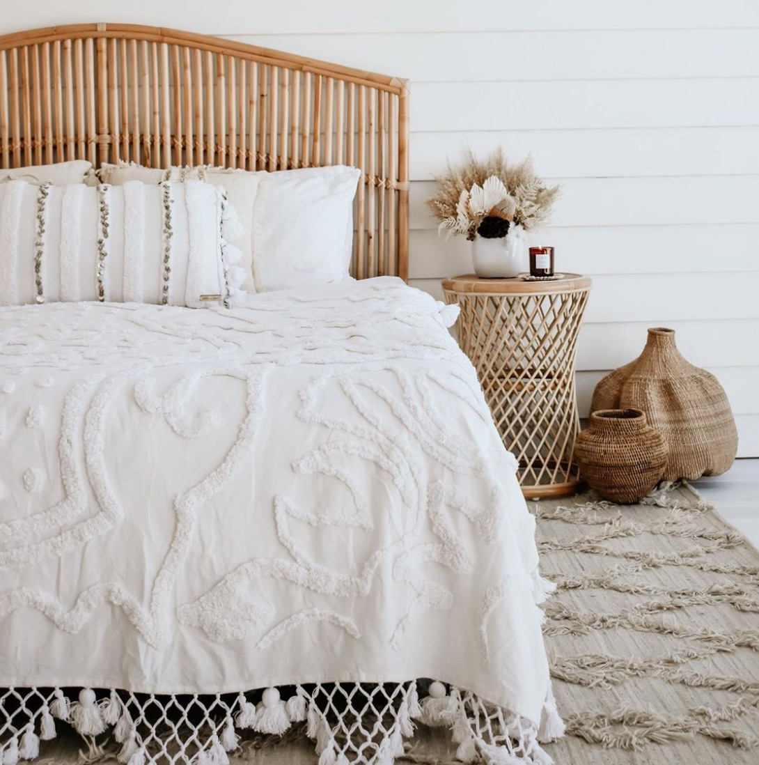 Rattan bedhead and white bedroom