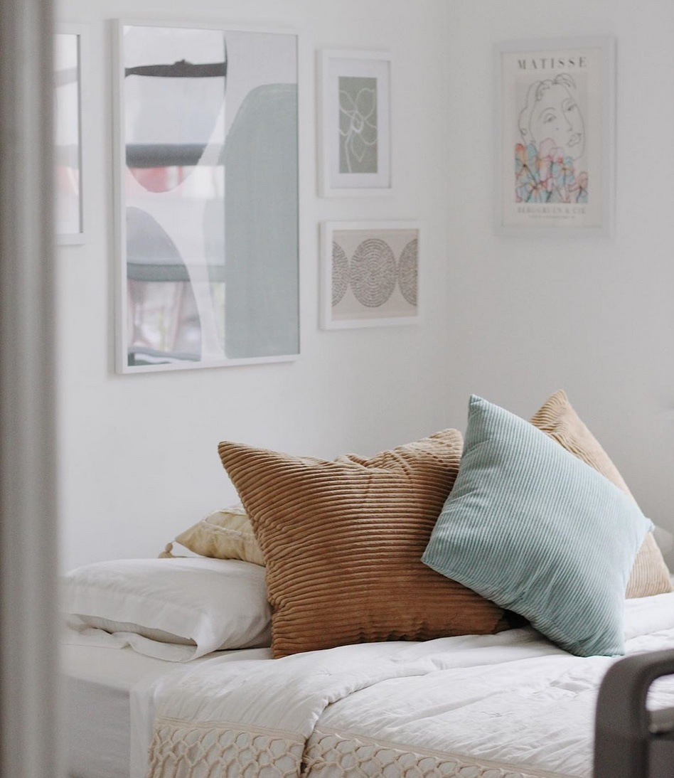 White bedroom and coloured cushions