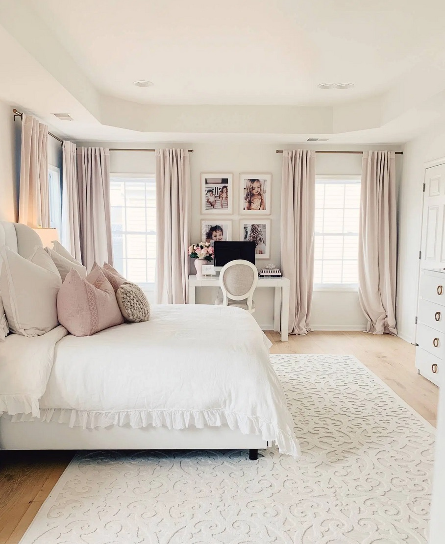 Large white bedroom with a desk